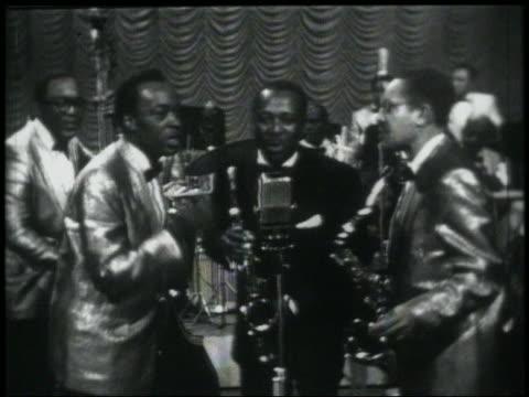 B/W 1950s/60s Louis Jordan his band singing 'Choochoo Chboogie' on stage