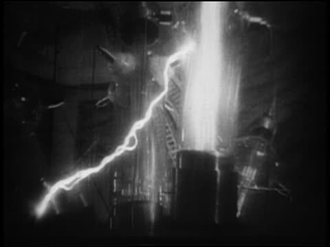 b/w 1950s/60s low angle close up glass tube of light producing electrical currents in laboratory - 1950 stock-videos und b-roll-filmmaterial