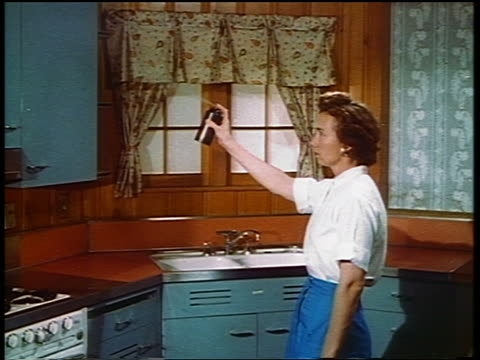 1950s/60s profile woman standing in kitchen spraying aerosol can (insecticide) in air - yorkville illinois stock videos & royalty-free footage