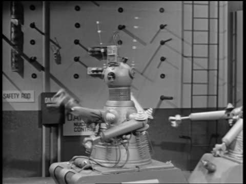 b/w 1950s/60s robot swinging arms around + shooting fire from tube - robot stock videos & royalty-free footage