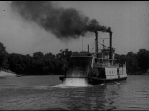 19th century riverboat ws sternwheel paddlewheel steam boat moving up tree lined river black smoke from dual stacks - wild west stock videos & royalty-free footage