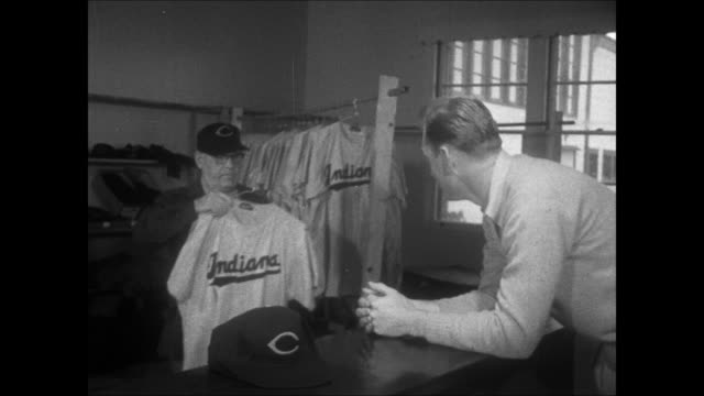 jim lemon and bob chakales walk into cleveland indians farm system club house / jim lemon is given his uniform - spring training stock videos & royalty-free footage
