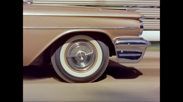 ms ts 1959s chevrolet car moving on road / united states - 1959 stock videos & royalty-free footage