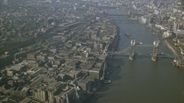 1960s ws aerial flying over river thames / london, uk - 1966 stock videos and b-roll footage