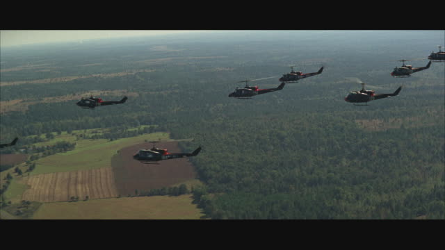 1960s aerial ws group of military helicopters in flight - formationsfliegen stock-videos und b-roll-filmmaterial