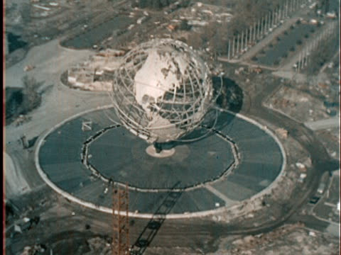 vídeos de stock e filmes b-roll de 1960s aerial unisphere at the 1964 world's fair site in flushing meadows/ queens ny - 1964