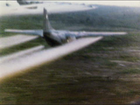 1960s aerial us military airplanes spraying agent orange over fields / vietnam - vietnam stock videos & royalty-free footage