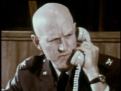 1960s ms air force officer giving instructions over telephone / plattsburgh, new york, united states - notfallplan konzepte stock-videos und b-roll-filmmaterial