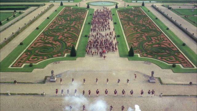 1960s WS HA TD Battle between peasants and guards in ornate gardens