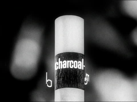 1960s black and white animation close up cigarette with animated words 'charcoal' and 'menthol' swirling around it / smoke emitting from cigarette / audio - advertisement stock videos & royalty-free footage