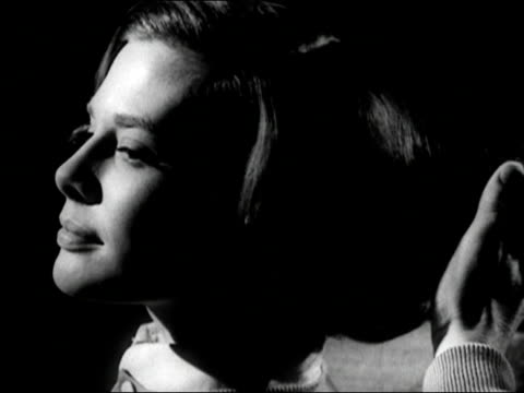 1960s black and white close up man running fingers through woman's hair / woman smiling at him and talking / audio - 1960 stock-videos und b-roll-filmmaterial