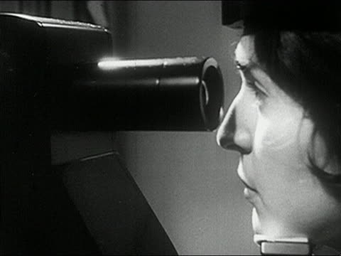 1960s black and white close up pan woman looking into apparatus during eye examination - optometrist stock videos & royalty-free footage