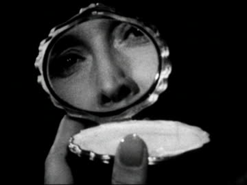 1960s black and white close up woman opening compact / woman's face reflected in mirror / woman breathing on mirror and fogging it up / audio - advertisement stock videos & royalty-free footage