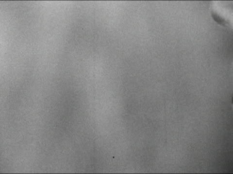 1960s black and white close up woman smoking cigarette and exhaling smoke / audio - cigarette stock videos & royalty-free footage