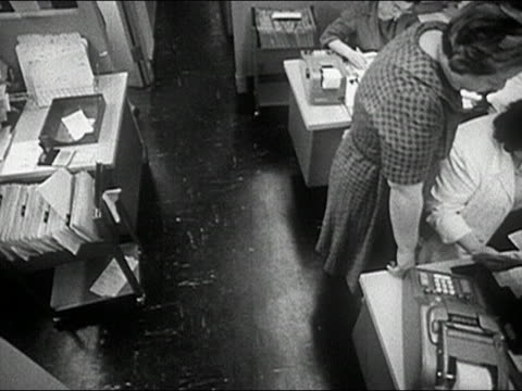 1960s black and white high angle crane shot overhead shot of women working in an office - crane shot stock videos & royalty-free footage