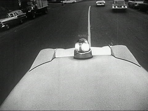 1960s black and white high angle point of view flashing light on ambulance driving down city street - emergency light stock videos & royalty-free footage