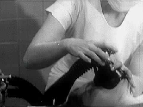 1960s black and white medium shot tilt down nurse giving woman in labor laughing gas - childbirth stock videos & royalty-free footage