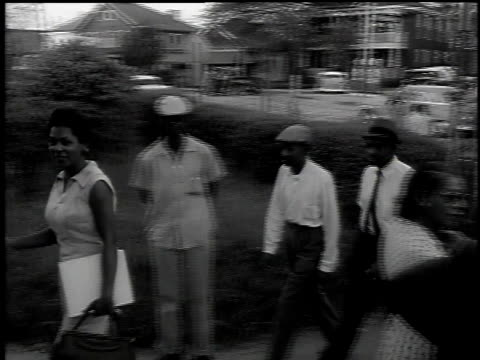 1960s WS Black men and women walking into polling station / United States