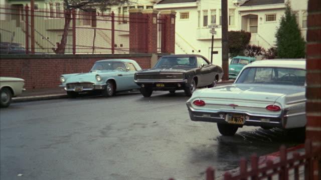 1960s ws pan black sedan on residential street / san francisco, california, usa - 1968 stock videos and b-roll footage