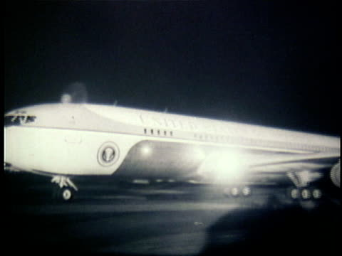 1960s B/W WS PAN Air Force One taxiing on runway / Unknown Location