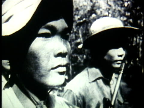 1960s b/w montage platoon of viet cong soldiers standing to attention in the jungle / north vietnam - north stock videos & royalty-free footage