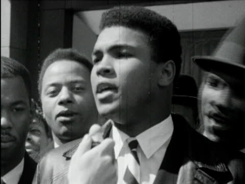 vídeos de stock e filmes b-roll de 1960s b/w ms zi cu muhammad ali interviewed / usa / audio - 1964