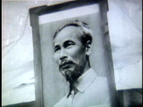 1960s b/w ms td portrait of ho chi minh above communist star / north vietnam - north vietnam stock videos & royalty-free footage