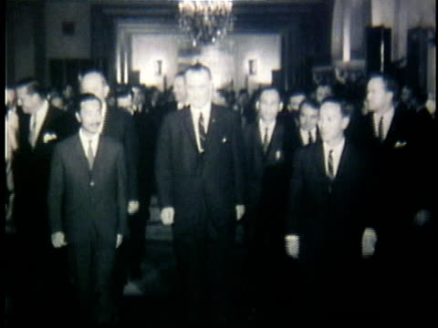 1960s b/w ws president lyndon johnson with south vietnamese leaders nguyen cao ky and nguyen van thieu / south vietnam - south vietnam stock videos & royalty-free footage