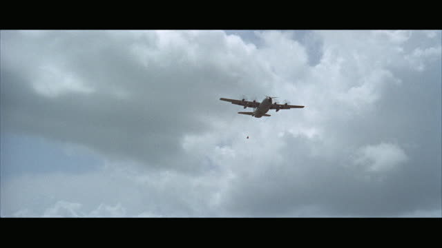 1960s ws la pan c130 plane flying past - letterbox format stock videos and b-roll footage