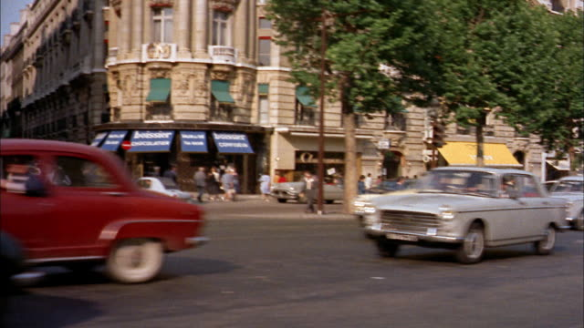 1960s car point of view busy tree-lined street passing stopped traffic and stores / paris - retail place stock videos & royalty-free footage