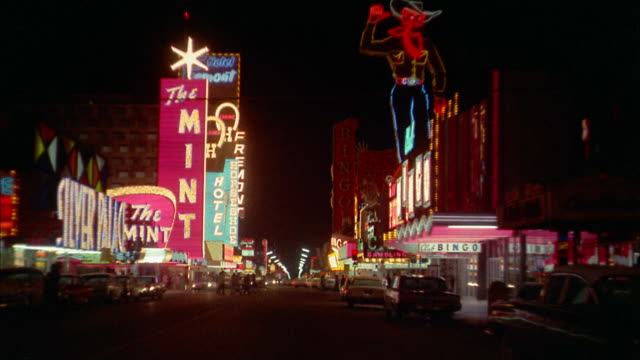 1960s car point of view neon signs and casinos on Las Vegas strip at night
