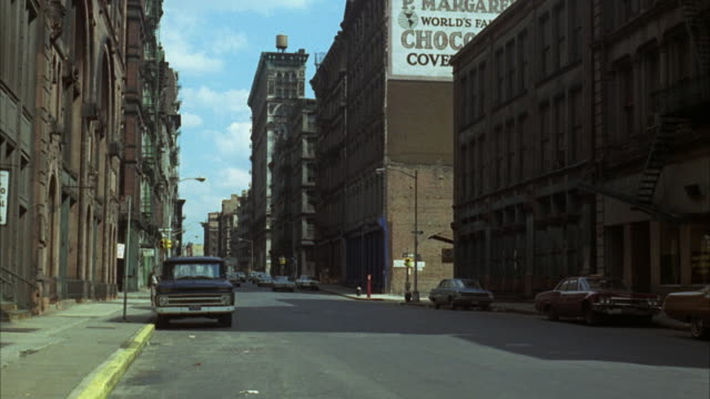 1960s ws car traffic in city / new york city, usa - 1960 1969 stock-videos und b-roll-filmmaterial