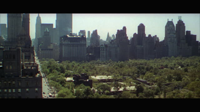 vidéos et rushes de 1960s ws ha central park with skyscrapers in background / new york city, usa - central park manhattan