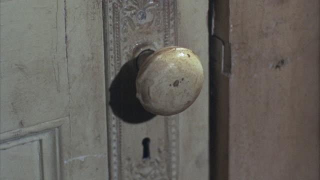 1960s cu tu chain lock on door - door chain stock videos & royalty-free footage
