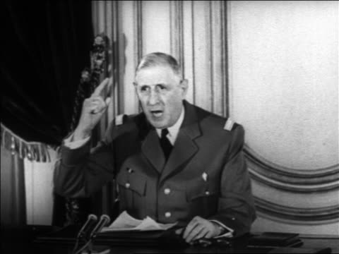 b/w 1960s charles de gaulle making televised speech about algerian problem / educational - charles de gaulle stock videos & royalty-free footage