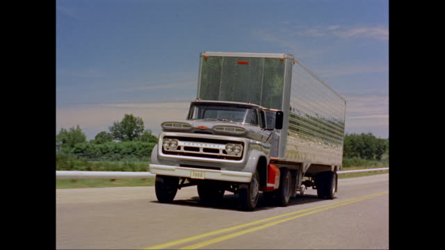 vidéos et rushes de ws ts 1960s chevrolet lorry moving on road / united states - chevrolet