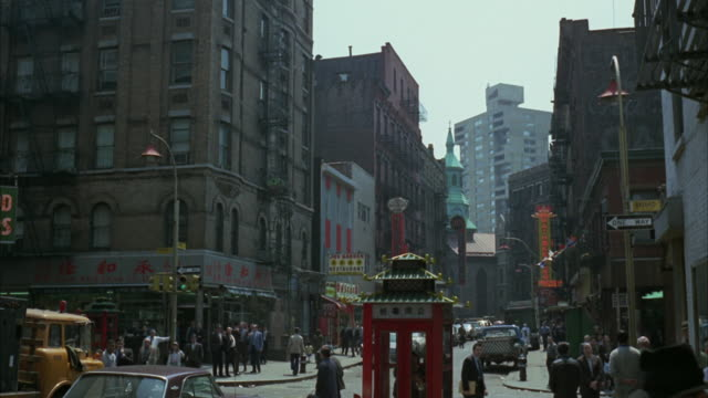 1960s ws chinatown street with traffic and pedestrian activity / new york city, usa - chinatown stock videos and b-roll footage