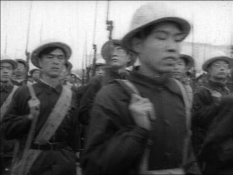 1960s chinese army marching past camera / china / educational - 20 29 years stock videos & royalty-free footage