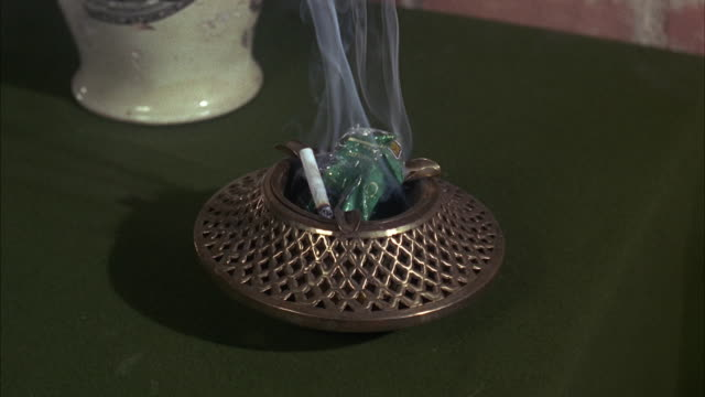 1960s cu cigarette pack burning in ash tray - smoking issues stock videos & royalty-free footage