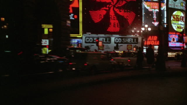 1960s ws pov city traffic with colorful signs / london, uk - neon stock videos & royalty-free footage