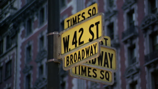 1960s close up 42nd street and broadway street signs in times square / nyc - ブロードウェイ点の映像素材/bロール
