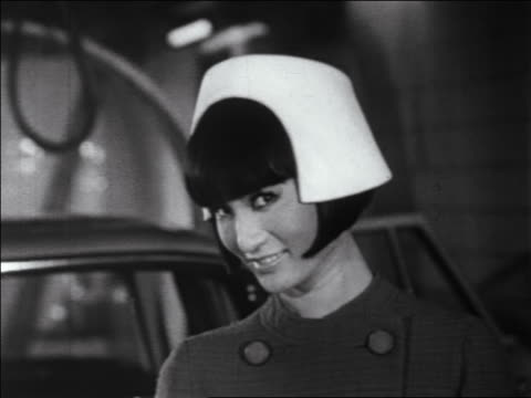 stockvideo's en b-roll-footage met b/w 1960s close up asian woman modeling white hat / newsreel - aziatische etniciteit