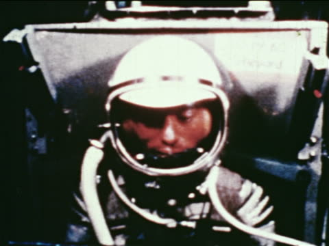 1960s close up astronaut in spacesuit sitting in centrifuge during training (may be gus grissom) - astronaut stock videos & royalty-free footage