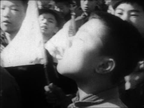 b/w 1960s close up chinese boy shouting marching during demonstration / china / educational - menschlicher arm stock-videos und b-roll-filmmaterial