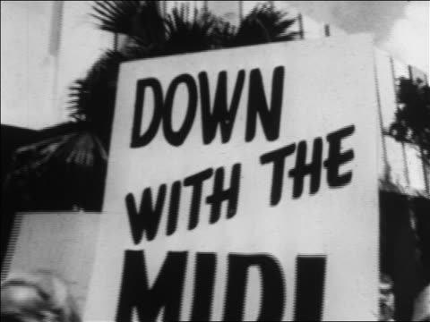 b/w 1960s close up down with the midi poster in demonstration / newsreel - mini skirt stock videos & royalty-free footage
