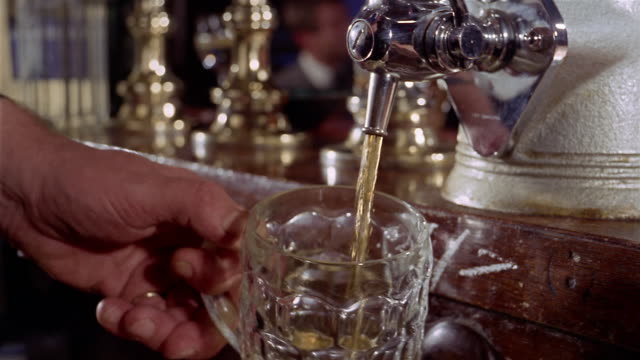 1960s close up filling glass mug with beer from tap - pub stock videos & royalty-free footage