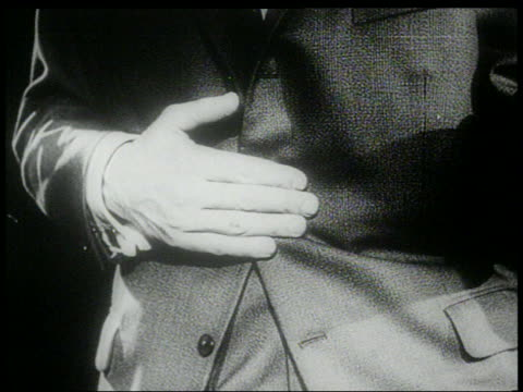 stockvideo's en b-roll-footage met b/w 1960s close up hand of man pressed against stomach as he does the twist - compleet pak
