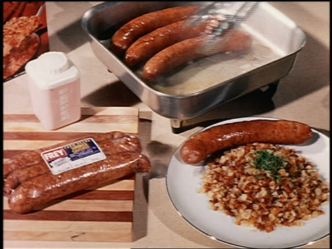 1960s close up hand using tongs to take sausage from cooker + putting it on dish with rice - yorkville illinois stock videos & royalty-free footage