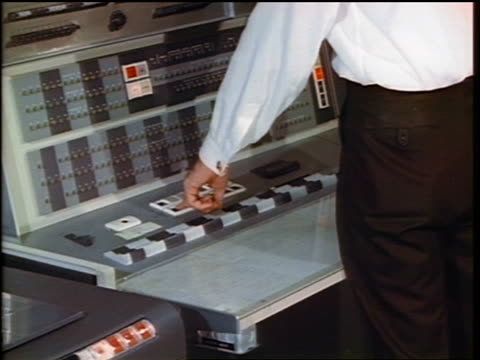 1960s close up man's hand pushing buttons on control panel of early computer - mainframe stock videos & royalty-free footage