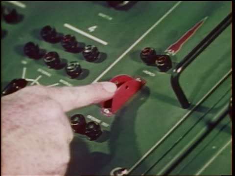 1960s close up man's hand pushing red switch on control panel to shoot missiles / cold war / documentary - cold war stock videos and b-roll footage